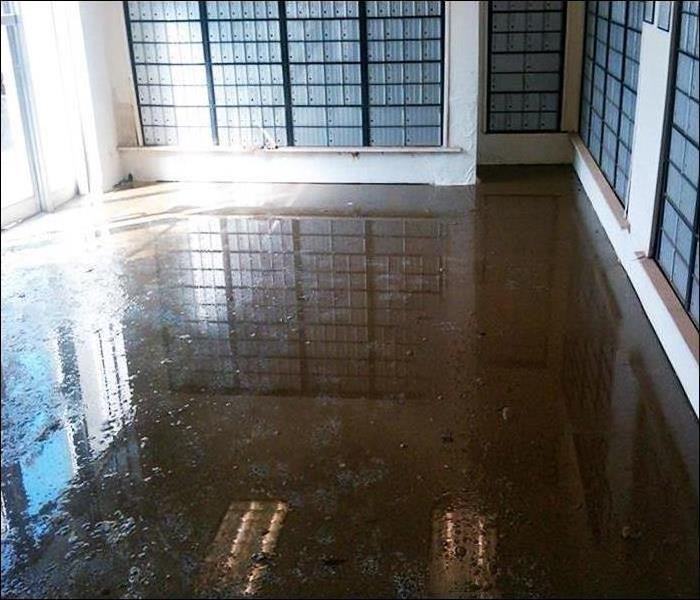 Sarasota Condo Flooding of Mail Room Before